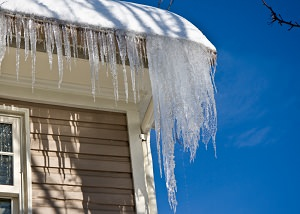 Ice damming on a VA home's roof and gutters
